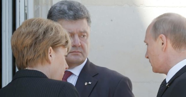 German Chancellor Angela Merkel with Poroshenko (center) and Putin in Normandy, France on 6 June 2014 [AP]