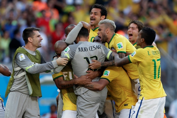Brazilian players react after a penalty shoot out at the end of the World Cup round of 16 soccer match between Brazil and Chile at the Mineirao Stadium in Belo Horizonte, Brazil, Saturday, June 28, 2014 [AP]