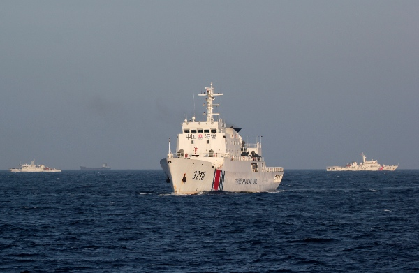 In this Thursday, May 15, 2014 photo, China Coast Guard vessels sail in the waters claimed by China and Vietnam in the South China Sea [AP]