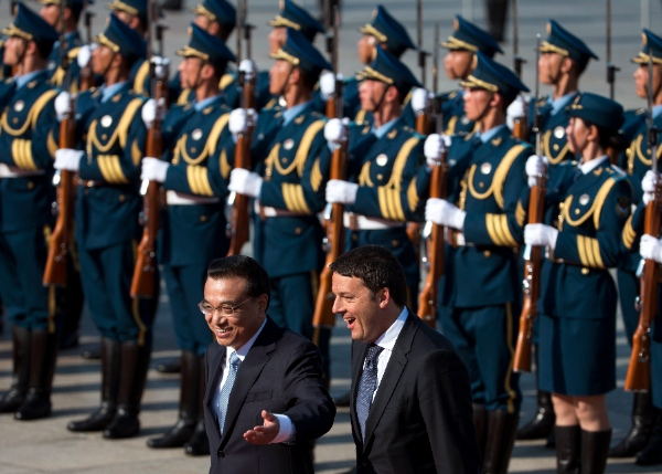 Italian Prime Minister Matteo Renzi, right, chats with his Chinese counterpart Li Keqiang after inspecting a guard of honor during a welcome ceremony outside the Great Hall of the People in Beijing, China Wednesday, June 11, 2014 [AP]