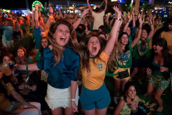 Soccer fans celebrate the second goal scored by Brazil striker Neymar, during a live broadcast at a World Cup viewing party at the Jockey Club, in Rio de Janeiro, Brazil, Thursday, June 12, 2014 [AP]