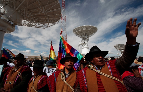 "Aymara Indigenous people attend the inauguration of the Bolivian satellite earth station in El Alto, Bolivia, Monday, Dec. 2, 2013. Bolivia launched their first satellite named ""Tupac Katari"", in honor to an Indian leader who was killed during a revolt against Spanish rule, from a launch site in China on Dec. 20. 2013 [AP]"
