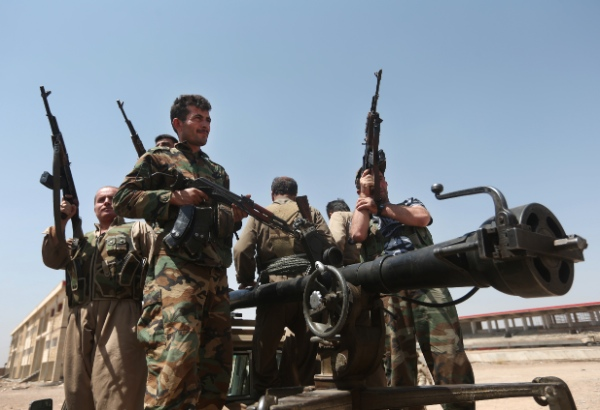Kurdish peshmerga fighters take positions on the front line with militants from the al-Qaida-inspired Islamic State in Iraq and the Levant (ISIL), in Tuz Khormato, 100 kilometers (62 miles) south of the oil rich province of Kirkuk, northern Iraq, Wednesday, June 25, 2014 [AP]