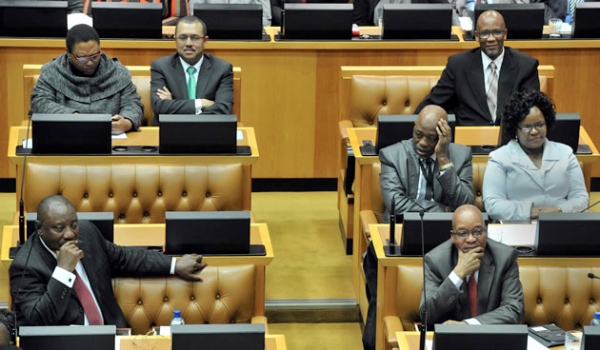 Deputy President Cyril Ramaphosa and President Jacob Zuma listening to a speaker during the SONA debate in Parliament on 20 June 2014 [GCIS]