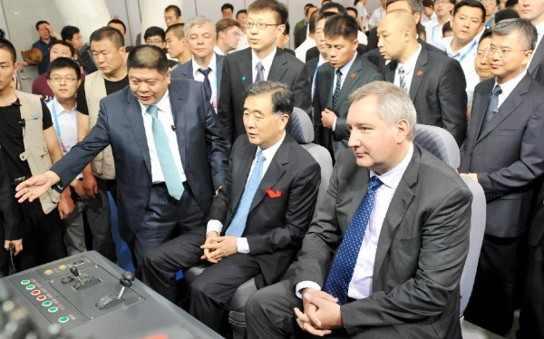 Chinese Vice Premier Wang Yang (2nd R front) and Russian Deputy Prime Minister Dmitry Rogozin (1st R front) visit the first China-Russia Exposition after attending the opening ceremony of Russian pavilion in Harbin, capital of northeast China's Heilongjiang Province, June 30, 2014 [Xinhua]