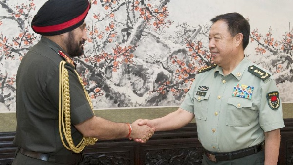 Vice Chairman of China's Central Military Commission Fan Changlong (R) meets with Indian Army Chief General Bikram Singh,, in Beijing, capital of China, July 3, 2014 [Xinhua]