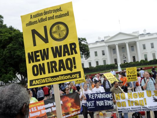 People demonstrate outside the White House against U.S. involvement in Iraq [AP]