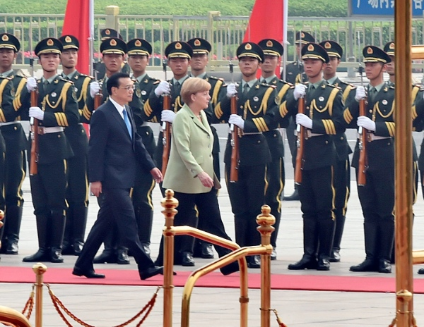 Chinese Premier Li Keqiang (front, L) holds a welcoming ceremony for visiting German Chancellor Angela Merkel in Beijing, capital of China, July 7, 2014 [Xinhua]