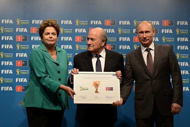 Putin (right) and Rousseff in a ceremonial handover of host duties for soccer's marquee tournament, which takes place in Russia in 2018 [PPIO]