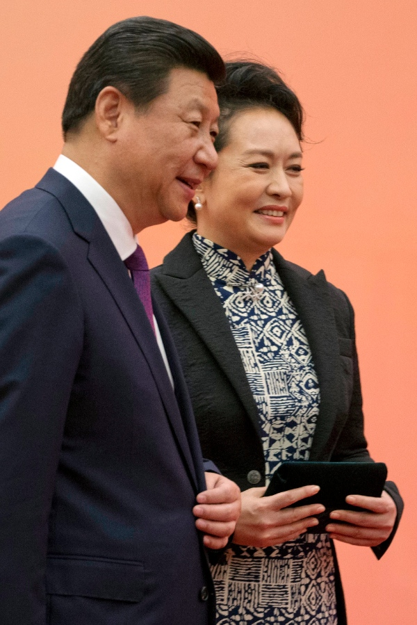 File photo of Chinese first lady Peng Liyuan, right, stands next to Chinese President Xi Jinping as they wait for state leaders to arrive for a group photo at the fourth summit of the Conference on Interaction and Confidence Building Measures in Asia (CICA) in Shanghai, China, Tuesday, May 20, 2014 [AP]