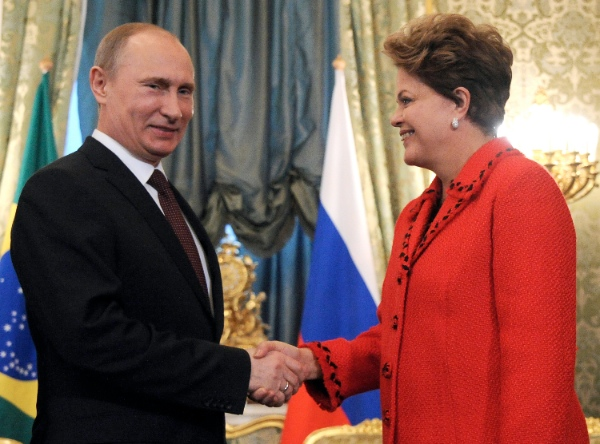 File photo of Russia's President Vladimir Putin, left, welcoming his Brazil's counterpart Dilma Rousseff, during a meeting in the Kremlin in Moscow [AP]