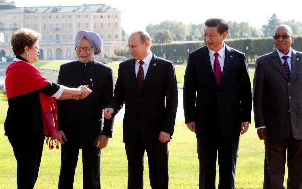 From left, Brazil's President Dilma Rousseff gestures to India's Prime Minister Manmohan Singh, Russia's President Vladimir Putin, China's President Xi Jinping and South African President Jacob Zuma as they gather for a group photo after a BRICS leaders' meeting at the G-20 Summit in St. Petersburg, Russia, Thursday, Sept. 5, 2013 [AP]