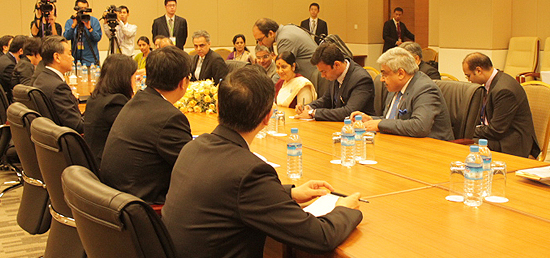 Chinese Foreign Minister Wang Yi held talks with his Indian counterpart Sushma Swaraj on the sidelines of the series of ASEAN Foreign Ministers' meetings on East Asia cooperation in Myanmar's capital of Nay Pyi Taw on 9 August 2014 [Xinhua]