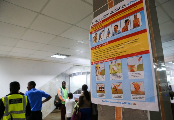 An Ebola awareness campaign poster warns passengers at Lungi Airport in Sierra Leone of the ways the virus is transmitted [Xinhua]