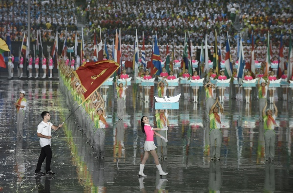 he flag bearer of Montenegro delegation parades into the stadium during the opening ceremony of Nanjing 2014 Youth Olympic Games in Nanjing, capital of east China's Jiangsu Province, Aug. 16, 2014 [Xinhua]