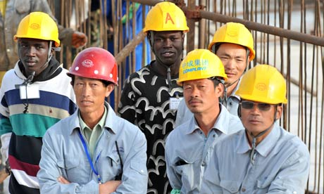 Senegalese and Chinese workers at a construction site in Dakar [Getty Images]