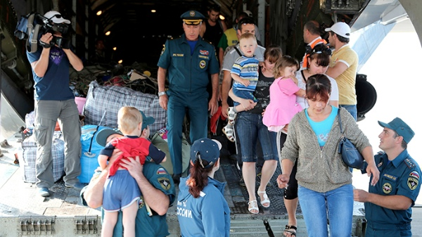 File photo of Ukrainian refugees on board Russian Emergency Ministry's aircraft in Makhachkala airport [Image: Ria Novosti]