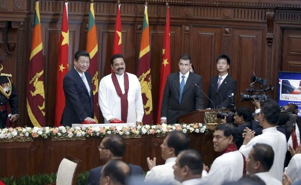 Chinese President Xi Jinping (2nd L) and his Sri Lankan counterpart Mahinda Rajapaksa (3rd L) attend a video-link launching of a coal power plant in Colombo, Sri Lanka, Sept. 16, 2014 [Xinhua]