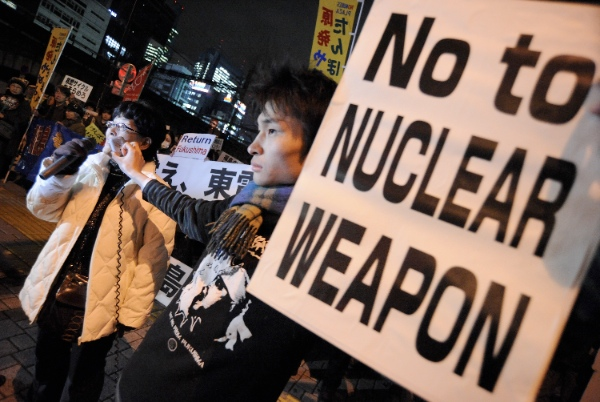 Protestors demonstrate outside the Tokyo Electric Power Company (TEPCO) in Tokyo, Japan, March 11, 2013 [Xinhua]