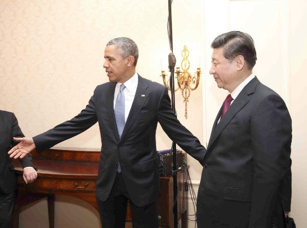 Chinese President Xi Jinping (R) meets with U.S. president Barack Obama in The Hague, Netherlands, March 24, 2014 [Xinhua]