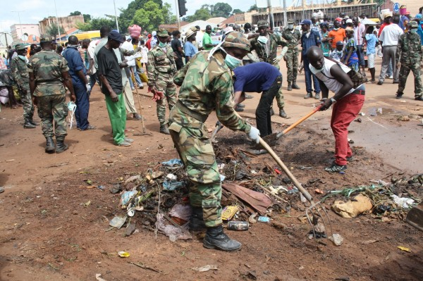 West African nations have deployed the military forces to help disinfection and containment efforts, such as the one above in Guinea [Xinhua]
