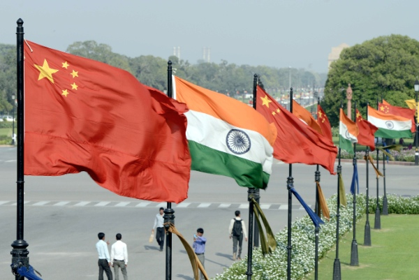 Indian and Chinese national flags flutter side by side at the Raisina hills in New Delhi, India, on Sept. 18, 2014 [Xinhua]