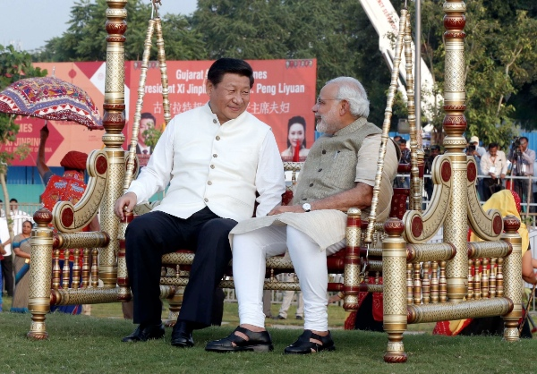 Chinese President Xi Jinping (L) talks with Indian Prime Minister Narendra Modi as they visit a riverside park development project in Gujarat, India, Sept. 17, 2014 [Xinhua]