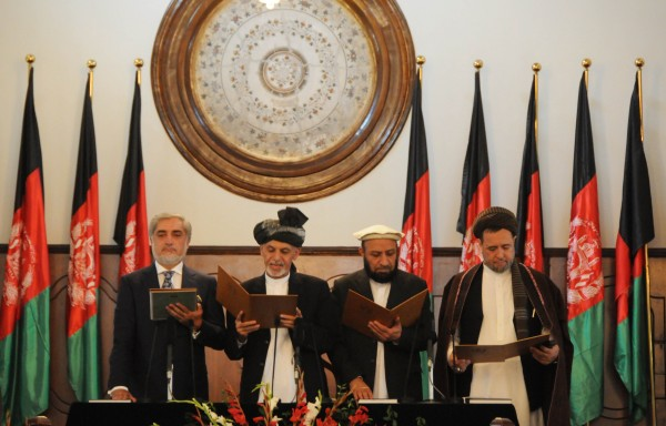 Ghani's (second from left) first act as president was to appoint Abdullah (far left) the chief executive officer of the country [Xinhua]