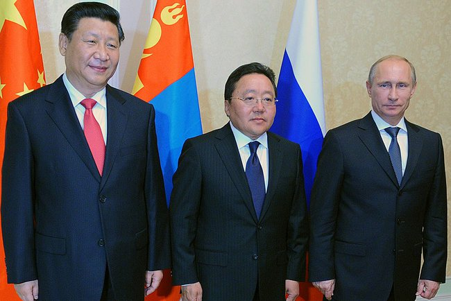 Xi held talks with his Russian and Mongolian counterparts Vladimir Putin and Tsakhiagiin Elbegdorj on 11 September 2014 in Dushanbe, Tajikistan [PPIO]