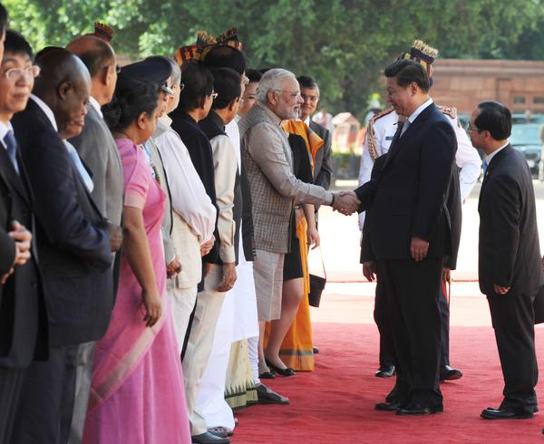 India and China have signed 12 agreements in Delhi, one of which will see China investing $20 billion in India's infrastructure over five years [Xinhua]