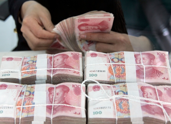 HSBC expects the yuan to be one of the top three global trade currencies by 2015 [Xinhua]