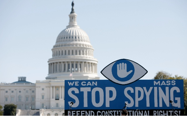 A huge slogan board stands in front of the U.S. Capitol building during a protest against government surveillance in Washington D.C., capital of the United Sates, on Oct. 26, 2013 [Xinhua]