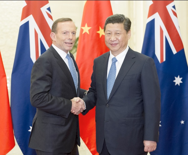 Chinese President Xi Jinping (R) meets with visiting Australian Prime Minister Tony Abbott at the Great Hall of the People in Beijing, capital of China, April 11, 2014 [Xinhua]