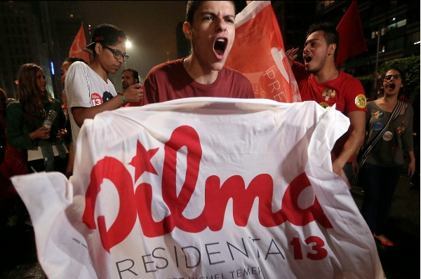 Supporters of the Brazil's President and candidate for Workers Party, Dilma Rousseff, celebrate in Paulista Avenue, in Sao Paulo, Brazil, on Oct. 26, 2014 [Xinhua]
