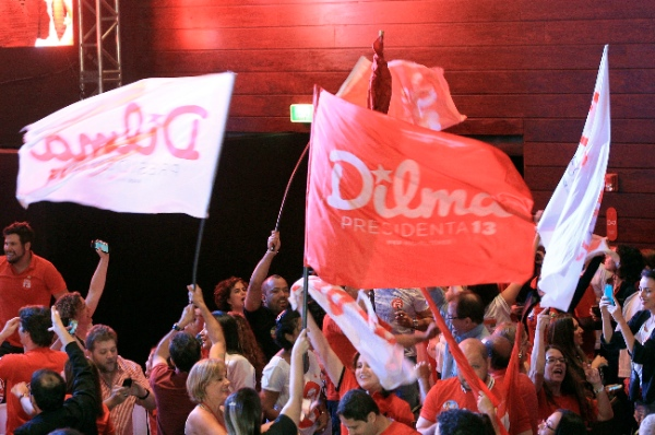 Supporters of the Brazil's President and candidate for Workers Party, Dilma Rousseff, react while waiting for her arrival at Raoyal Tulip Hotel, in Brasilia, Brazil, on Oct. 26, 2014 [Xinhua]