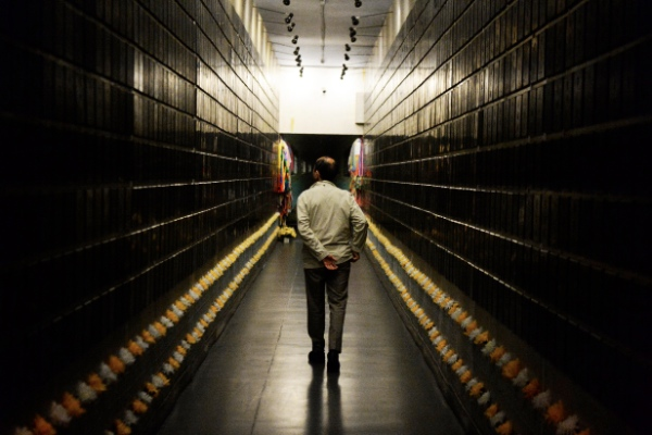 A member of a Japanese medical delegation walks between walls bearing the names of Unit 731 victims in Harbin, capital of northeast China's Heilongjiang Province, May 4, 2014. A Japanese medical delegation visited the site of Unit 731, a Japanese biological and chemical warfare research troop during World War II, in Harbin in May 2014 [Xinhua]