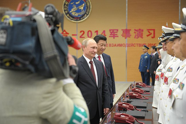 Xi has held talks or met with Putin for nine times since he assumed the office of China's President in March 2013 [PPIO]