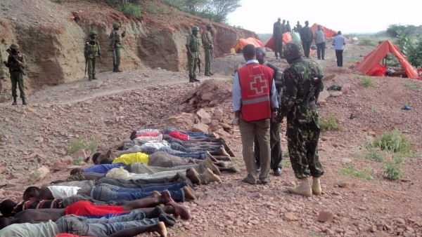 Red Cross staff walk past the bodies of dozens of executed quarry workers near the Somali border. Separating Christians from Muslims and then executing them has been a modus operandi for the extremist group [Xinhua]