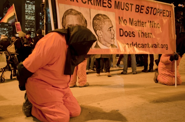 Activists are dressed up as prisoners to protest American torture in Chicago on Dec.10, 2014. Around 200 anti-violence activists held a peaceful assembly on the International Human Rights Day in Chicago [Xinhua]