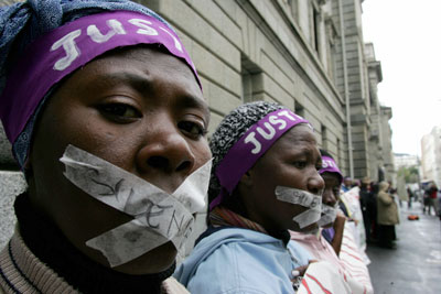 File photo of activists campaigning for  justice for women and rape survivors outside a Cape Town High Court, South Africa [AP]