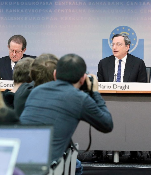 quantitative easing, announced last week by the European Central Bank's president, Mario Draghi (right) [Xinhua]