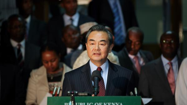 Chinese Foreign Minister Wang Yi speaks to reporters after talks with his Kenyan counterpart Amina Mohamed in Nairobi, capital of Kenya, Jan. 10, 2015 [Xinhua]