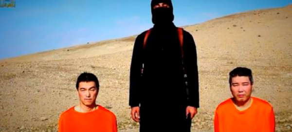A screen capture of the ISIL video which was released on social media on Tuesday. It has since been shown in parts on major news networks. The masked ISIL militant warned Japan that it had 72 hours to pay a $200-million ransom
