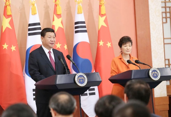File Photo: Chinese President Xi Jinping (L) and South Korean President Park Geun-hye jointly meet journalists after their talks in Seoul, South Korea, July 3, 2014 [Xinhua]