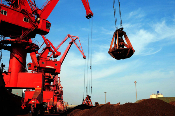 Freighters load iron ore at the Rizhao Port in Shandong province [Xinhua]