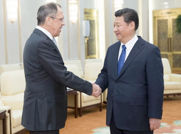 Chinese President Xi Jinping (R) meets with Russian Foreign Minister Sergey Lavrov in Beijing, capital of China, Feb. 2, 2015 [Xinhua]