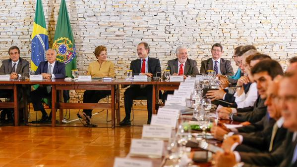 Brazilian President Dilma Rousseff (3rd from left) with her newly sworn-in Cabinet Ministers, including Finance Minister Joaquim Levy (extreme right).