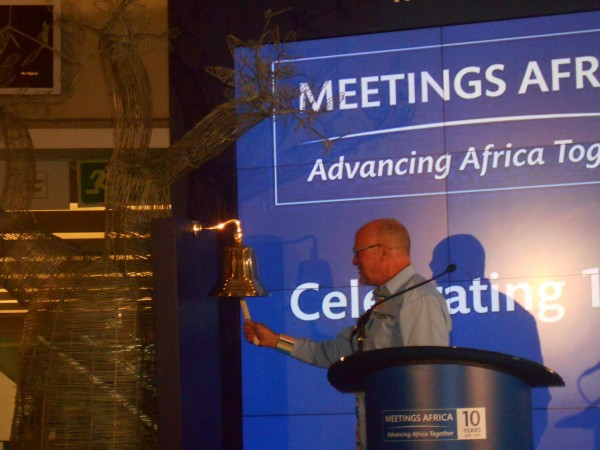 South African Tourism Minister Derek Hanekom ringing the bell to officially open Meetings Africa 2015 at the Sandton Convention Centre on February 24 [TBP]