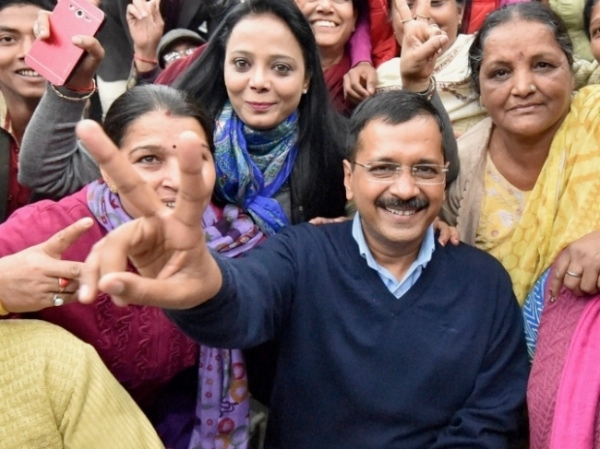 AAP supremo Arvind Kejriwal with supporters on February 10, 2015 [PTI]