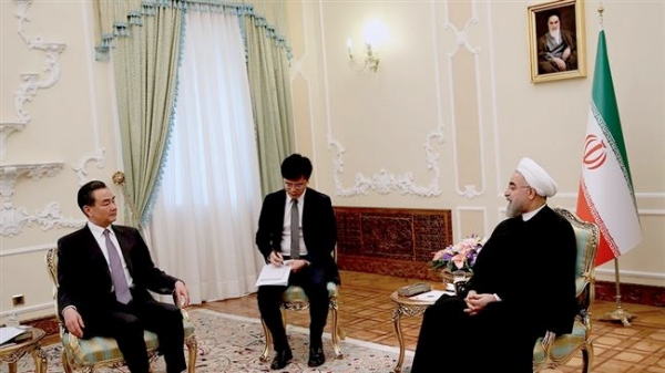 Iranian President Hassan Rouhani (right) with Chinese Foreign Minister Wang Yi in Tehran, Iran on 15 February 2015 [Xinhua]